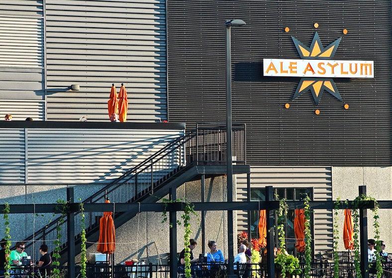 Ale Asylum outdoor seating with logo